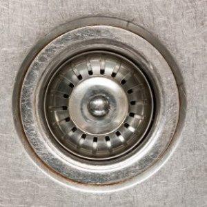 Metal sink drain.
