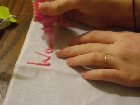 Closeup of painting verbs on bandanas.