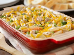 A pan of chicken casserole made with noodles and veggies.