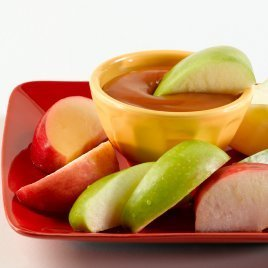 Plate of apples and caramel dip.