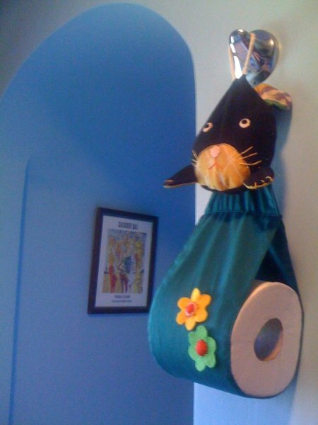 Hanging bunny toilet paper holder.