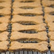 Homemade Dog Treat Recipes, Rows of homemade dog biscuits cooling on a rack.