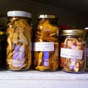 Jars of dried food on a shelf.