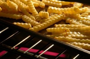 Pan of french fries in the oven.