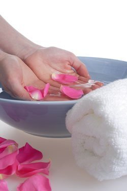 A bowl of rose petals for soaking hands or feet.