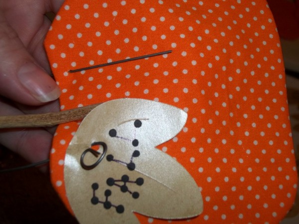 Attaching a leaf using craft wire.