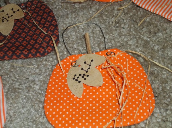 Finished pumpkin with raffia attached to wire.