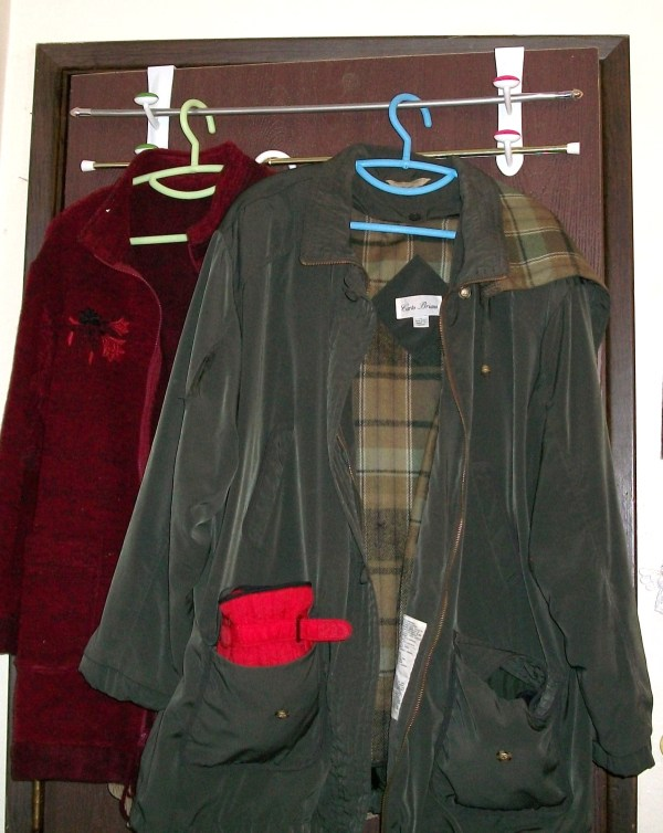 Two jackets hanging from unit.