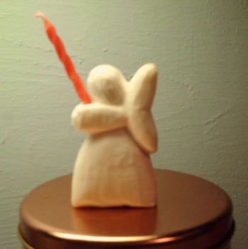 Photo of an angel carved out of soap.