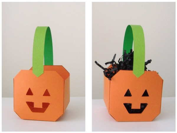 Two pumpkin baskets, side by side, one onthe right has black filler in it.