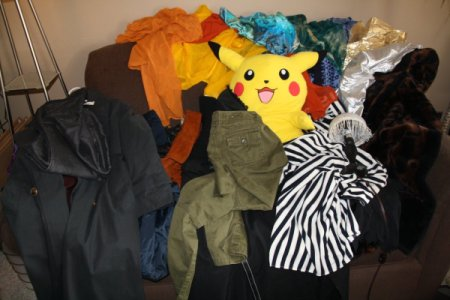 Clothes Piled on a Couch After Shopping Trip