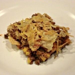 Beef nacho casserole on a plate.