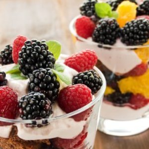 Fresh fruit and yogurt partait in glass dishes.