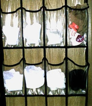 Organizing socks with an over the door shoe organizer.