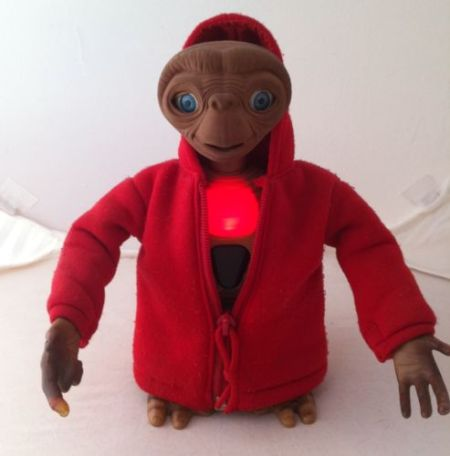 ET doll in a red hoodie.