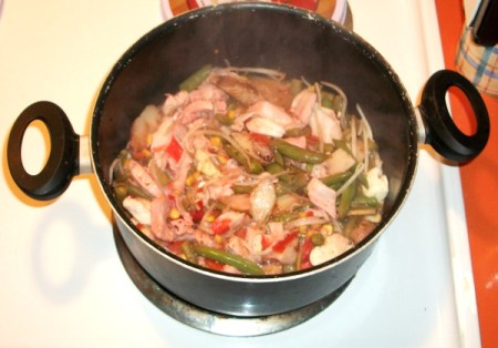 Pink stir fry in  a pot.