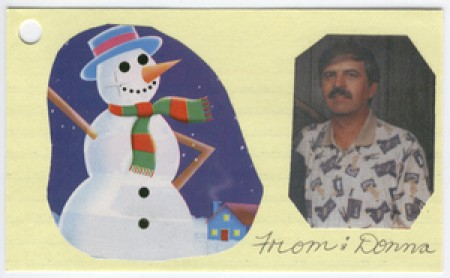 Gift tag with a photo on it of the gift recipient.
