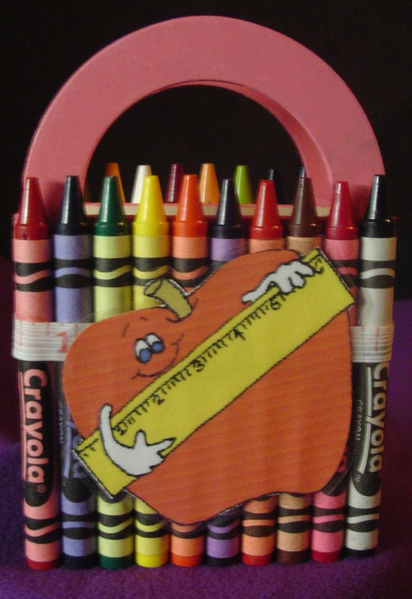 Crayons covering a wooden basket