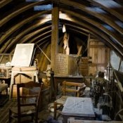 Boat keel style attic with clutter.