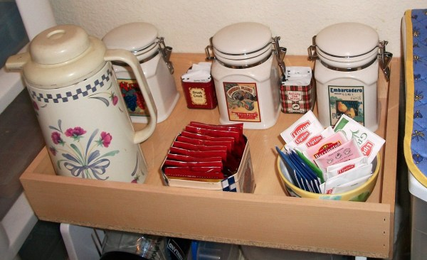 Wooden box with tea, coffee, canisters, carafe, etc.