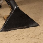 Someone using a carpet cleaner.