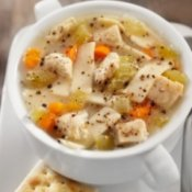A bowl of hearty chicken noodle soup.