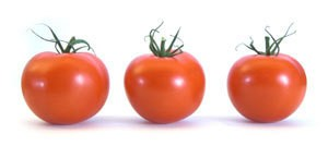 Photo of three tomatoes.