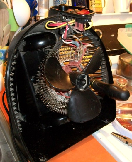 Disassembled heater with socket handle visible.