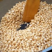 Wooden Spoon Stirring Kettle Corn