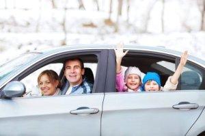 Family in Car Leaving in Winter
