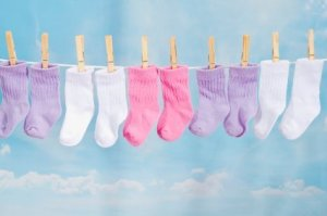 Pairs of Baby Socks on a Clothesline