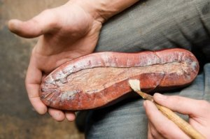 Man Repairing a Shoe