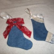 Two completed stockings, one with lace and one with bandana fabric.