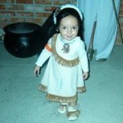 A young girl in a Pocahontas costume.
