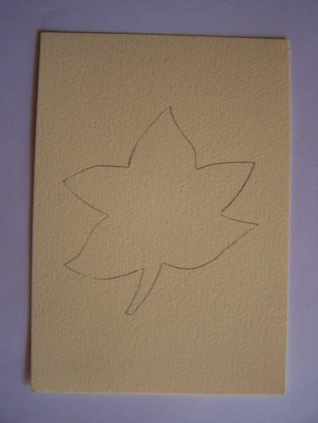 Outline of leaf pattern on brown paper.