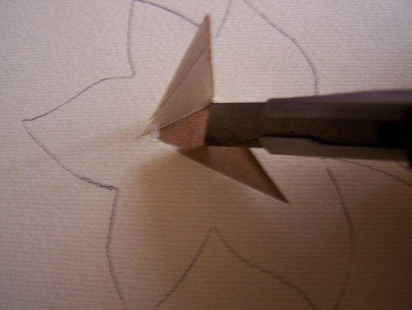 Stanley knife cutting center of leaf pattern.