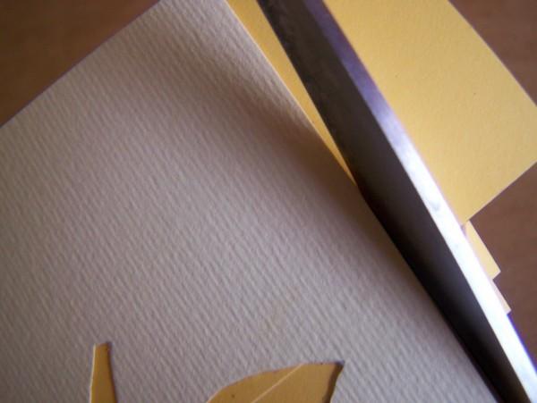 Clpseup of trimming paper edges.