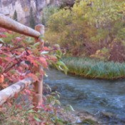 Fence in the Fall With River in Background