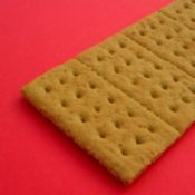 Graham cracker on a red background.