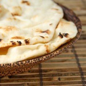 Naan in wooden bowl.