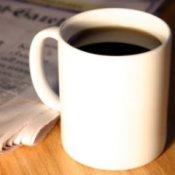Hot coffee mug on wood table.