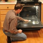 Man cleaning the oven.