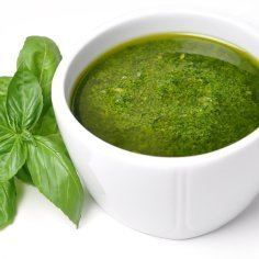 Pesto sauce in a white bowl.