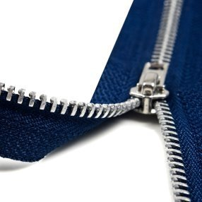 A blue zipper that is half way unzipped.