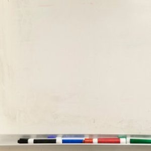 A dry erase board and markers.