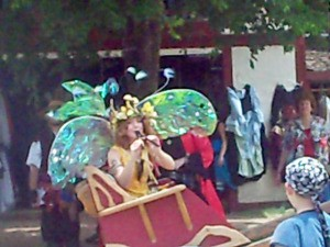 Woman Playing Pan Flute with Iridescent Wings on