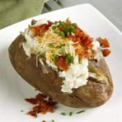 A baked potato with a lot of toppings.