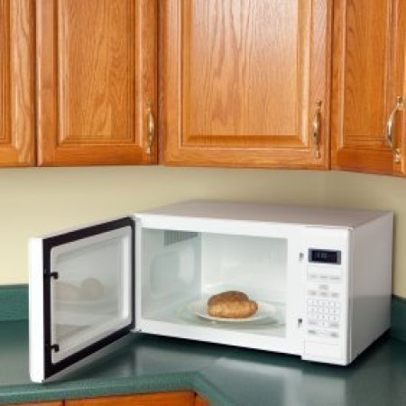 Potatoes on a plate in the microwave.