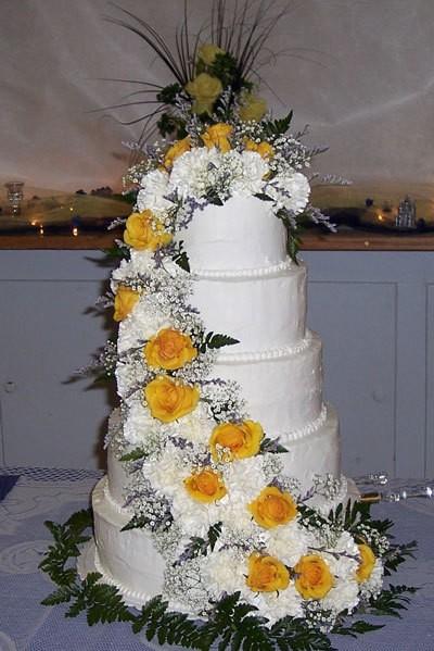 Photo of a large white wedding cake.