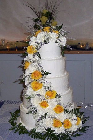 Photo of a large white wedding cake.
